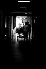 Hospital hallway (Just a guy who likes to take pictures) Tags: street light portrait people bw en white black holland haarlem netherlands lamp monochrome silhouette hospital way hall und bed bett europa europe die candid wheels gang nederland thenetherlands silhouettes tunnel hallway medical staff health human crew end holanda care huis zwart wit weiss paysbas halle schwarz krankenhaus ziekenhuis wielen silhouet dokter niederlande zw the silhouett zuster weis gast gasthuis kennemer kennemergasthuis niederlaende neiderlnde
