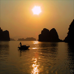 The magic of H Long Bay (NaPix -- (Time out)) Tags: life sunset red sea orange sun seascape reflection nature water beauty landscape hope gold islands golden boat twilight fisherman rocks waves glow peace waterfront dusk earth air unescoworldheritagesite vietnam explore top10 lanscape tms silohette sealevel tellmeastory explored explore1 exploretopten vnhhlong hlongbay napix bestcapturesaoi bestofmywinners bitlong 4elementsfire bchlongv