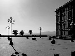 la piazza al sole (gufino (out for awhile)) Tags: sardegna blackandwhite ombre riposo cielo luci piazza sole cagliari vacanza biancoenero tranquillità