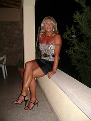 Legs crossed and bare to show off my tan. (nicegurlnicki) Tags: tv highheels legs tights tgirl transgender tranny blonde transvestite hosiery stiletto trav miniskirt crossdresser crossdress sarong tg