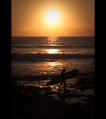 The Day Is Over (Gerg) Tags: ocean light sunset sea summer sun man reflection beach sport canon spain rocks surf waves surfer sigma tenerife summertime canaryislands surfin 500d 1770mm sigma1770mmf2845dcmacro platinumheartaward