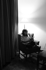 Bedtime stories (Pixychik) Tags: cactus bw lamp girl canon reading book solitude alone desert reader room couch story bedtime spines thorn drapes hpc pastime thorny fleshy pixychik
