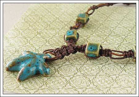 Knotted porcelain bead necklace