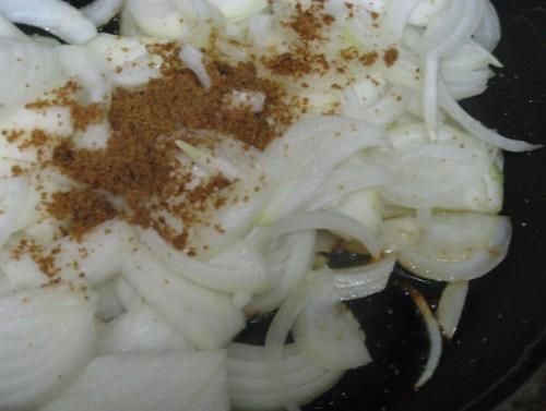 Sliced onions with a pinch of brown sugar