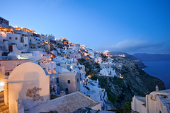 Oia after sunset - Santorini (Scott Norsworthy) Tags: travel cliff buildings lens island volcano europe paint sigma wideangle santorini greece caldera bluehour 1020 oia whitewash