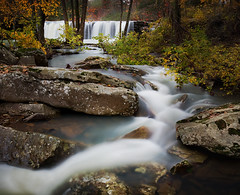Fall at Falling Water Falls (clay.wells) Tags: county autumn pope fall nature water rock forest canon lens landscape flow photography eos waterfall interesting october rocks stream long exposure place stitch natural zoom you 1st outdoor clayton wildlife wells falls falling explore management national area arkansas usm polarizer cascade 2009 ef 1740mm circular ozark creeks waterscape piney bigmomma f4l 40d challengeyouwinner thechallengefactory thepinnaclehof tphofweek17 img272927pano riverninjajumpstompin