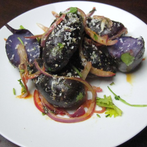 purple potatoes with cotija and onions