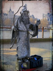wizard (topcat_angel) Tags: canona710is humanartstatue buskerbusking silverwizardstickwandrod riverthameslondoncity boatwaterskyrailing musicboxredbrolly bordertexturefilllight