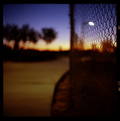 Park Sidewalk at Sunrise (Bright Lights, Vegas Nights) Tags: park 120 6x6 tlr film sunrise fence mediumformat square lasvegas bokeh sidewalk twinlensreflex yashicad canoscan8800f ektar100