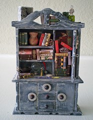 Bookworm Wizard Enchanted Cabinet ~ 1:12 Scale (Enchanticals~ Death in Family) Tags: wood moon clock reading miniature comedy time furniture handmade wizard collectible bookcase homedecor dollhouse masque dioramas bookworm halfmoon scrolls littlethings wizardry miniaturedoor oneinchscale etsylove roomboxes 112thscale dollhouseminiature onetwelfthscale etsyartists etsyteams minimakers dontmakeascene damteam scaledollhouseminiature teammids enchanticals miniaturedollhousescale minitreasures handcraftedminiatures enchanticalsetsy cabinetwithdoors miniaturesindollhousescale miniaturecollector 112scaledollhousescale dollhousesandminiaturesforthem addictedtominis fantasydollhousesandminiatures miniaturesgeneral alteredboxesminiatures fantsycrafts jackintheboxdollhousesandminiaturesforthem etsysellersonflickr estsyhandmadeandvintage