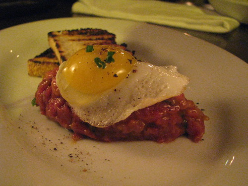 Beef tartare with juniper berry, fried quail egg & olive oil toasted bread