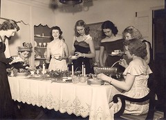 Oh, please let me get through this evening without spilling any punch on the tablecloth. (sctatepdx) Tags: found diningroom vernacular crazyhat punchbowl vintagedresses youngladies vintagehat vintagegowns whataspread