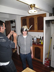 galen fashioning me a viking hat (the talent family) Tags: dec2008