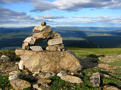 (Northwest haidaan) Tags: sunset mountains grass clouds rocks bluesky yukon inukshuk 2009 whitehorse mcintyre