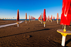la spiaggia surreale (buttha) Tags: sea italy beach sand italia mare shadows surreal tokina1224 ombre beachhut ombrelloni spiaggia grado sabbia beachumbrella friuliveneziagiulia surreale