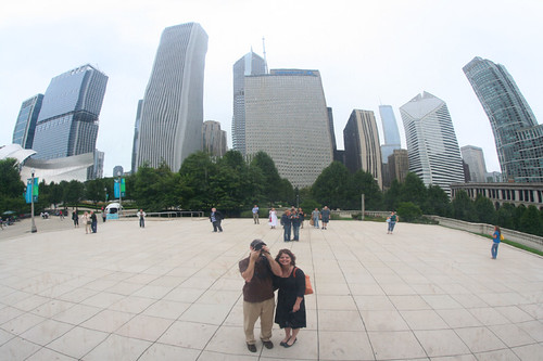 us and the skyline as reflected in the Cloud Gate