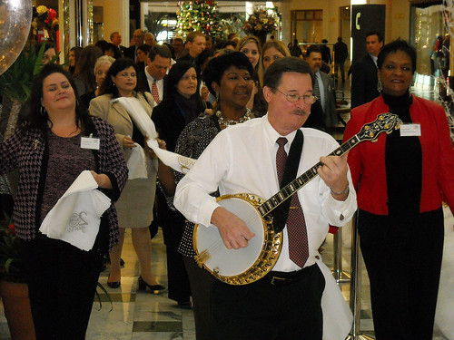 The Storyville Stompers lead the group in a second line to the ribbon cutting for the new LTFS refund center.