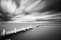 The Barrier (DolliaSH) Tags: longexposure light sea sky blackandwhite bw holland blancoynegro water monochrome clouds canon eos lights mono movement topf50 nederland thenetherlands wolke wolken explore filter le nubes nuvens nuage nuages topf100 frontpage nube stellendam skyer wolk zuidholland kumo 1755 moln nubi 1755mm zwartenwit canonefs1755f28isusm nd110 canoneos50d bwpolarizer 10stops oblaka dollia silvereffexpro dollias sheombar dolliash bw10stopsolidndfilter