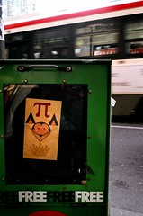 Pi Rat King (Georgie_grrl) Tags: toronto ontario blur green rat downtown whiskers pi pentaxk1000 crown streetcar newspaperbox kingstreetwest nowmagazine triangleears freefreefree cans2s rikenon12828mm reallypointyears littleredbeadytriangleeyes someonesurelikespointythingsandtriangles pointygrintoo pointylittleteethtoo