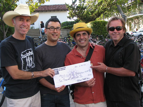 The Tall Bike Posse present their check to the SLO County Bicycle Coalition (from left to right) Sheriff Bill Mulder, Adam Fukushima of the SLO County Bicycle Coalition, Deputy YD Dan Kallal, and Sheriff Tom Smith.