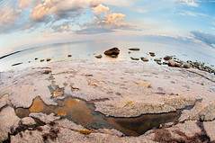 Coastal smile (Rob Orthen) Tags: sunset sea sky rock suomi finland landscape nikon europe scenic rob fisheye explore pools scandinavia meri maisema vesi archipelago kes pinta d300 orthen roborthenphotography seafinland nikon105mm28fisheye goldenreflexion