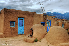 Taos Pueblo,  New Mexico Blue (bigredproduction) Tags: door new old blue vacation brown house mountain newmexico building art history tourism window beautiful stone america mexico cool ancient nikon oven mud native indian awesome pueblo tourist historic nativeamerican hut american ladder taos cracks artifact hdr cracked d3 photomatix nikond3