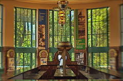 Water Bar (FotoEdge) Tags: windows light water glass colors stone lensbaby clouds reflections town shadows bright warmth missouri springs dreams minerals mirrored glowing wpa richness winds moods f4 patina hotsprings historicplace fsa hallofwaters excelsiorsprings tiled waterbar grittiness fotoedge impressedbeauty longestintheworld