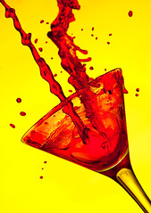 Splash!! (david.kittos) Tags: red colour macro glass yellow martini liquid strobist lightscience