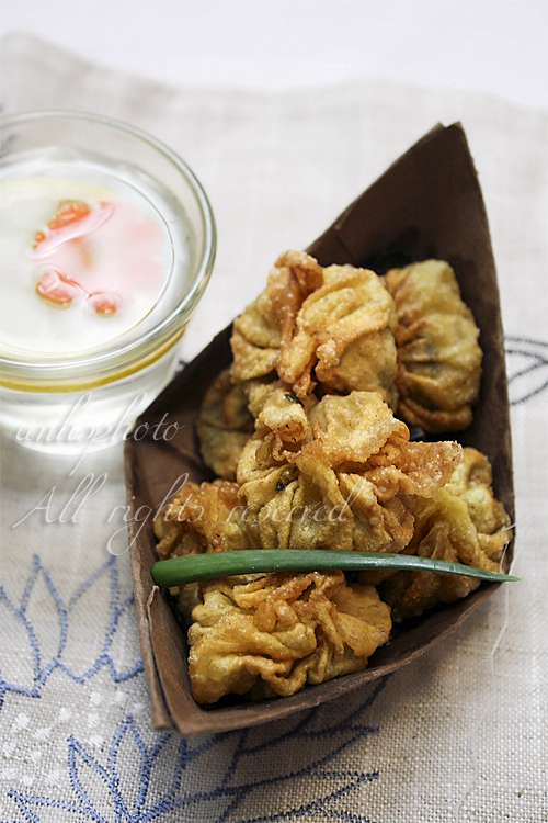 Fried vegetarian wonton in paper boat