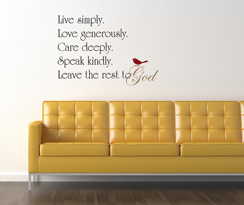 Leave the Rest to God on white wall with yellow couch
