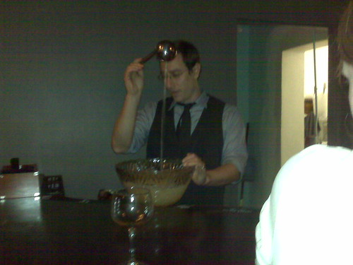 Owner Derek Brown mixing punch