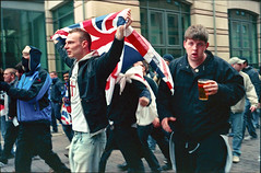 Waving flags (Jane Hoskyn) Tags: nottingham film 35mm demo flag politics protest 200iso explore pointandshoot analogue olympustrip35 fascists c41 edl explored negscans diycolour patersontank agfapro200 epsonv500 tetenalcolortec kitchensinkdarkroom diyprocess