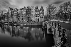 Clouds and reflections (angheloflores) Tags: amsterdam canal houses architecture travel longexposure clouds sky colors blackandwhite monocrome cityscape keizersgracht bridge lights night city urban explore netherlands