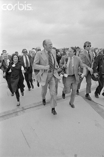 President Ford breaks into a run and laughingly leads the press back to the plane