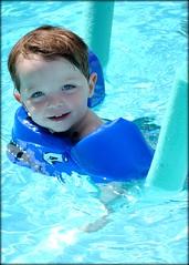 little swimmers (jinjur71) Tags: blue summer portrait water pool swim outdoors noodle floaties boychild