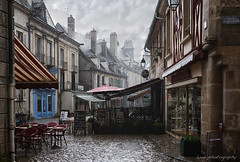 A sudden downpour - Port du Semur, Semur en Auxois, Cote d'Or, France (lyon photography) Tags: street windows roof france brick wet beer lamp rain sign stone umbrella square awning restaurant pub shoes chairs wine burgundy grill guinness cover signage tables shops balconies shelter pillars cobbles drainpipe blackboard dripping rooves cotedor bsalcony semurenauxios lightcloudrain portdusemur ruedurenaudot