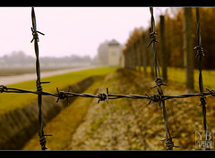 Dachau, Germany (Yen Baet) Tags: germany munich deutschland europe dof nazi jews dachau 1945 barbwire crematorium concentrationcamp persecution wwll prisoners guardtower nikond200 worldwarll