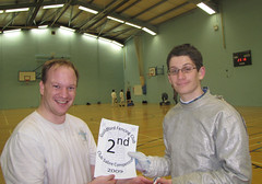 Michael receives the second-place certificate trophy from Matthew Gourlay