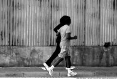 153 - woman: shadow of the man (Atakan Sevgi) Tags: street shadow blackandwhite woman man male men island women angle muslim islam perspective hijab culture jogging maldives sokak glge kadn maldivler kapal trban a kou mslman