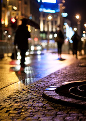 Karl Johans gate, Oslo (John Erik) Tags: street city people reflection wet oslo norway night lights nikon neon colours bokeh streetlights walk cobblestone rainy nikkor karljohansgate d300 brostein mennesker 50mmf14af