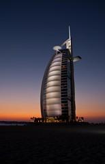 Daaaaa... Burj. (jrodmanjr) Tags: city travel blue sunset beach night hotel evening long exposure dubai desert dusk united uae resort emirates arab burjalarab hour unitedarabemirates burj