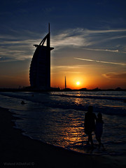 Life as a Sea (Waleed Ibrahem) Tags: sunset sun tower beach girl digital children hotel al heaven dubai united uae olympus emirates arab perm  guillaume ibrahim waleed   jumeirah burj                               zuiko1442mm    e620   aldokhail     lifeasaseatreatyourlifeasasea yourheartasaseashore andfriendslikewavesitnevermattershowmanywavesaretherewhatmattersis howmanywavestouchedtheseashore