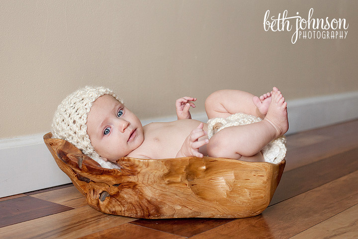 three month baby girl in wooden trencher bowl