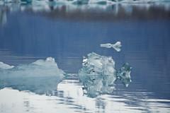 slither (helveticaneue) Tags: trip blue vacation sky mountain lake black reflection water june iceland europe glacier iceberg scandinavia 2009 icebergs lsland daytwo jkulsrln