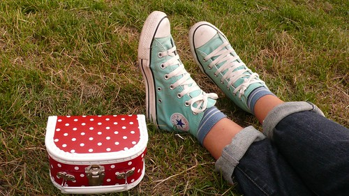 Blue Converse, red bag