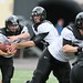 Junior quarterback Drew Hubel hands off to freshman running back Ben Bowen