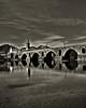 Ponte de Lima #2 (_madmarx_) Tags: bridge sky mountains portugal rio stone architecture reflections puente arquitectura ponte nubes pedra cpl vianadocastelo xsi piedra capela filtro riolima pontedelima stoantonio canoneos450d madmarx
