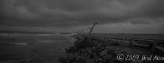 Escollera (Uriel Akira) Tags: ocean sea bw lighthouse storm blancoynegro beach clouds mexico faro mar blackwhite waves playa bn shore nubes tormenta veracruz olas oceano coatza coatzacoalcos escolleras seabreake
