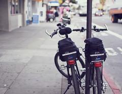 twinset (greenkozi) Tags: sf sanfrancisco street bike bicycle dof bokeh pair twin sidewalk mission 35mm14l 50d soyeah geotaggedbutcantfigureitout