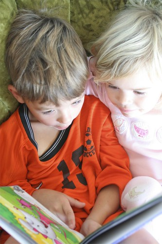 brother reading to sister